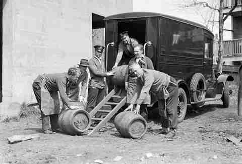 Men loading kegs onto truck