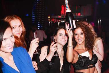 Drinking in a strip club