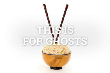 vertical chopsticks in rice