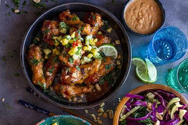 Thai peanut wings with fiery pineapple jalapeño salsa