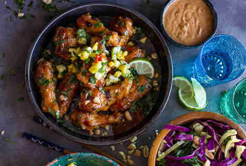 Thai peanut wings with fiery pineapple jalapeño salsa