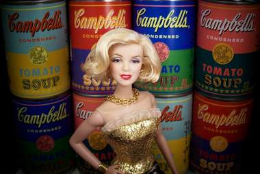 Marilyn Monroe Barbie in front of Warhol Campbell's soup cans