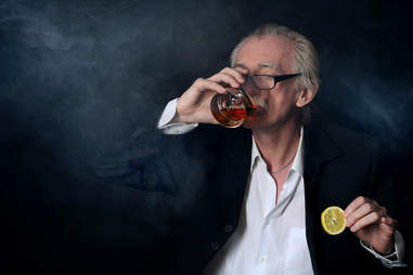 Old man drinking whiskey