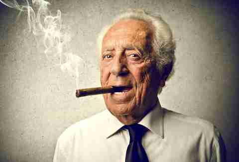 Old man smoking cigar