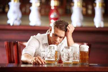 guy with beers sitting at bar