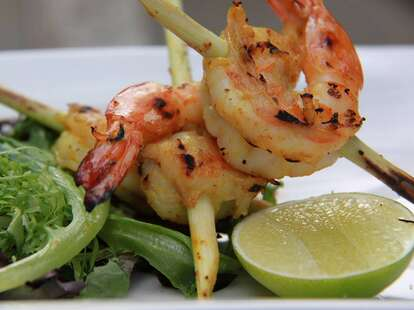 grilled shrimp skewer and lime at baan thai in washington dc