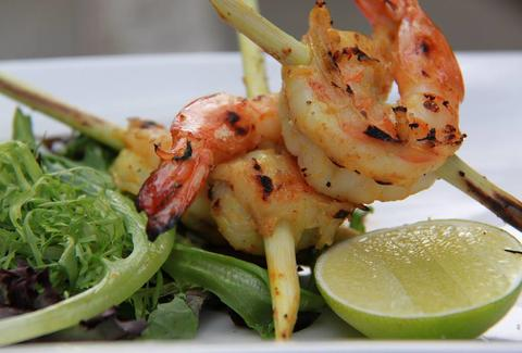 grilled shrimp skewer and lime at baan thai in washington dc