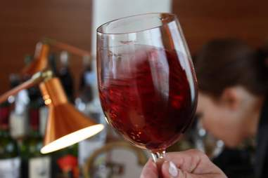 swirling a glass of red wine at barcelona wine bar and restaurant
