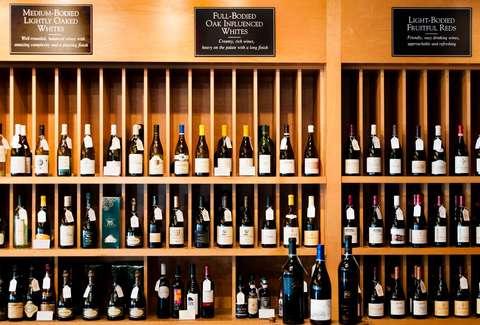 shelves of wine bottles at murphyu0027s wine & The Best Wine Bars in Atlanta - Where to Find Wine in ATL - Thrillist