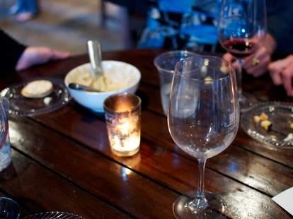outdoor patio at Times Ten Cellars wine glass Dallas
