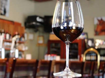 glass of red wine at d'vine bistro and wine bar in chandler arizona