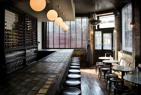 dark wood long bar interior sager & wilde thrillist london