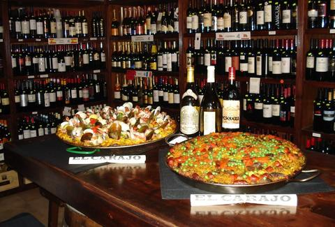 paella and wine bottles at The Forge Restaurant and Wine Bar