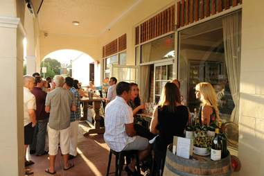 patrons gathered and talking at la cave d'azur