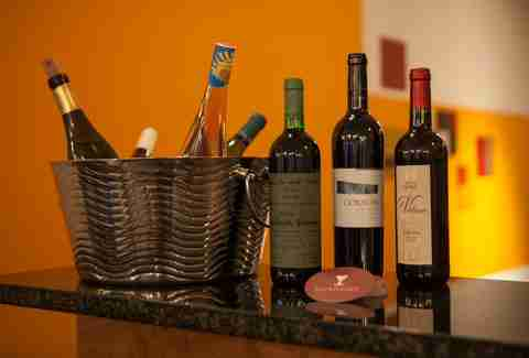 bottles of wine in a basket at Uvaggio