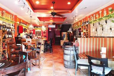 interior of Vinos in the Grove, barrels and chairs