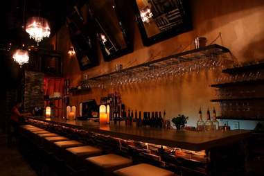 bar with candles andw ine glasses at wine vault in miami