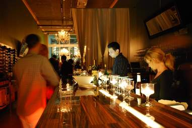 people at the bar of Bin 18, candlelight