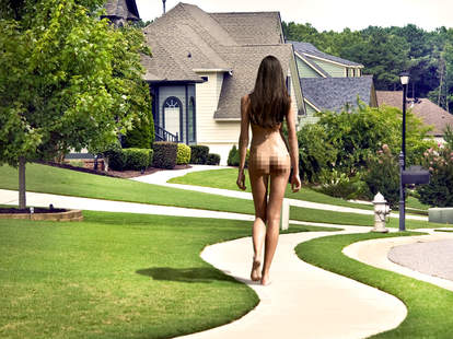naked woman walking in neighborhood