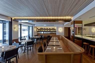 Empty interior shot of a.Kitchen + bar