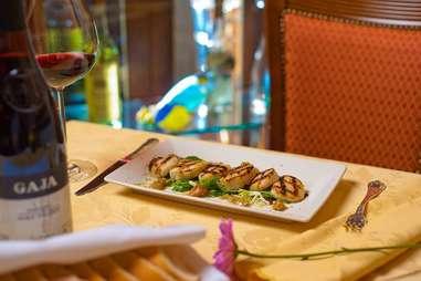 Small plate dinner and glass of red wine at La Famiglia Ristorante