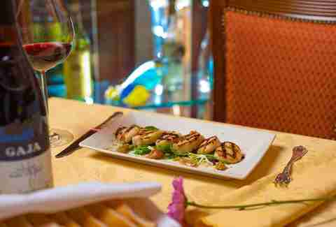 Small plate dinner and glass of red wine at La Famiglia Ristorante