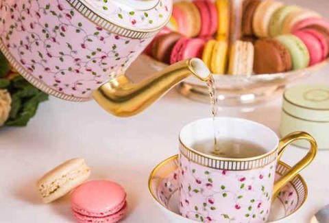 two macarons and tea at laduree paris