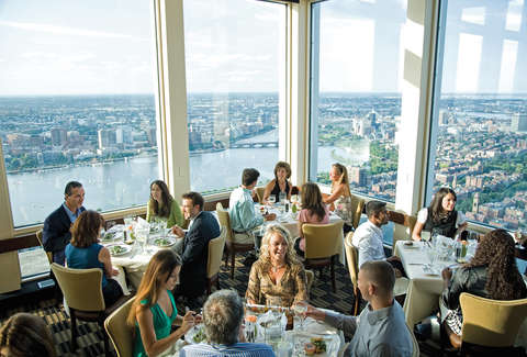 people dining at top of the hub boston