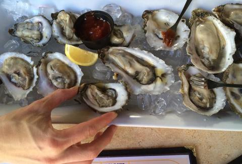 a dozen oysters at shoal creek saloon in Austin