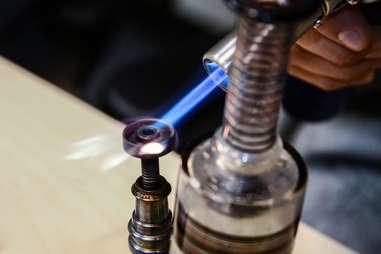 dabbing cannabis with a nail and butane blowtorch