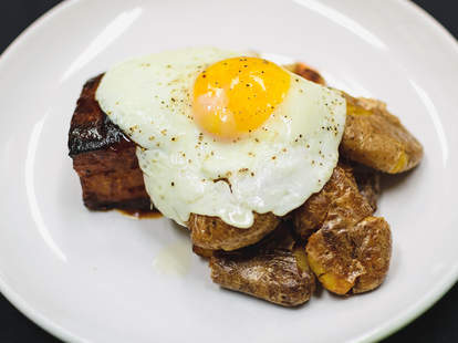 Eggs on roasted potatoes and pork belly