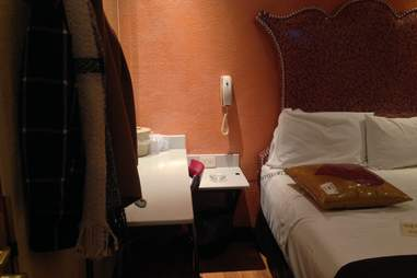 Bed in hotel room with phone next to it