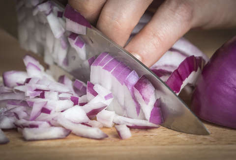 i tested and ranked the best ways to cut an onion without crying