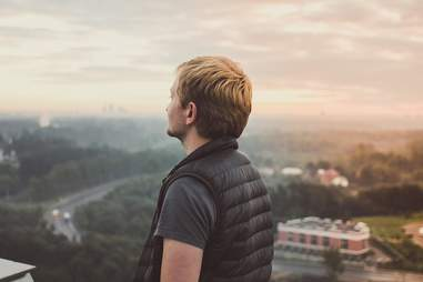 Man in vest looking out over city