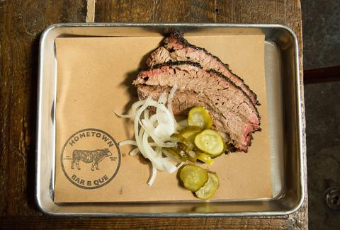 Hometown Bar B Que tray with smoked meat, pickles and onions