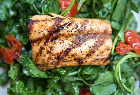 grilled Salmon on a bed of spinach salad