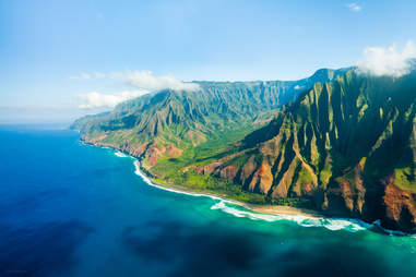 An aerial panorama shot taken from a helicopter of the rugged Na Pali Coast in Kauai, Hawaii