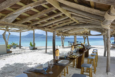 Beach table at Petit St Vincent resort on the Caribbean island with the same name
