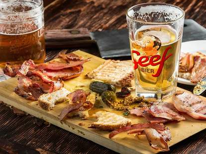 pints of beer with cheese and charcuterie board at Paddy Long's