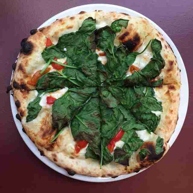 pizza with cheese, tomatoes and greens from The Flortentine