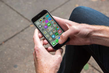 Man checking his apps on the iPhone 6s smartphone