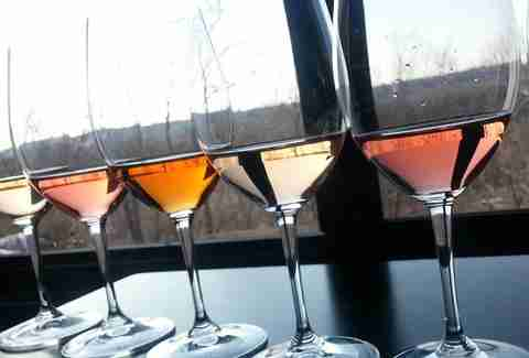 Glasses of white wine and Rose against a window at The Lab at Sunfish Cellars