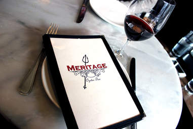 menu and glass of red wine at meritage