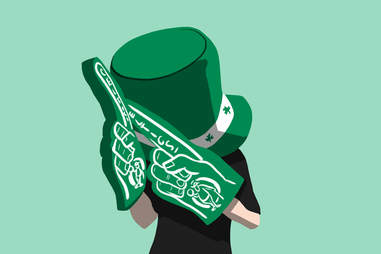 Celtics superfan with oversize hat and fingers