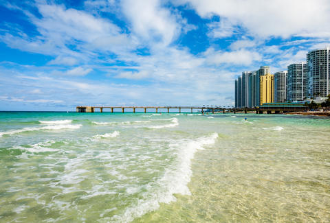 North Beach Miami Ocean With Pier Coast Condos And Other Buildings In Florida