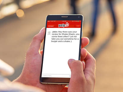 Person on Yelp on smart phone