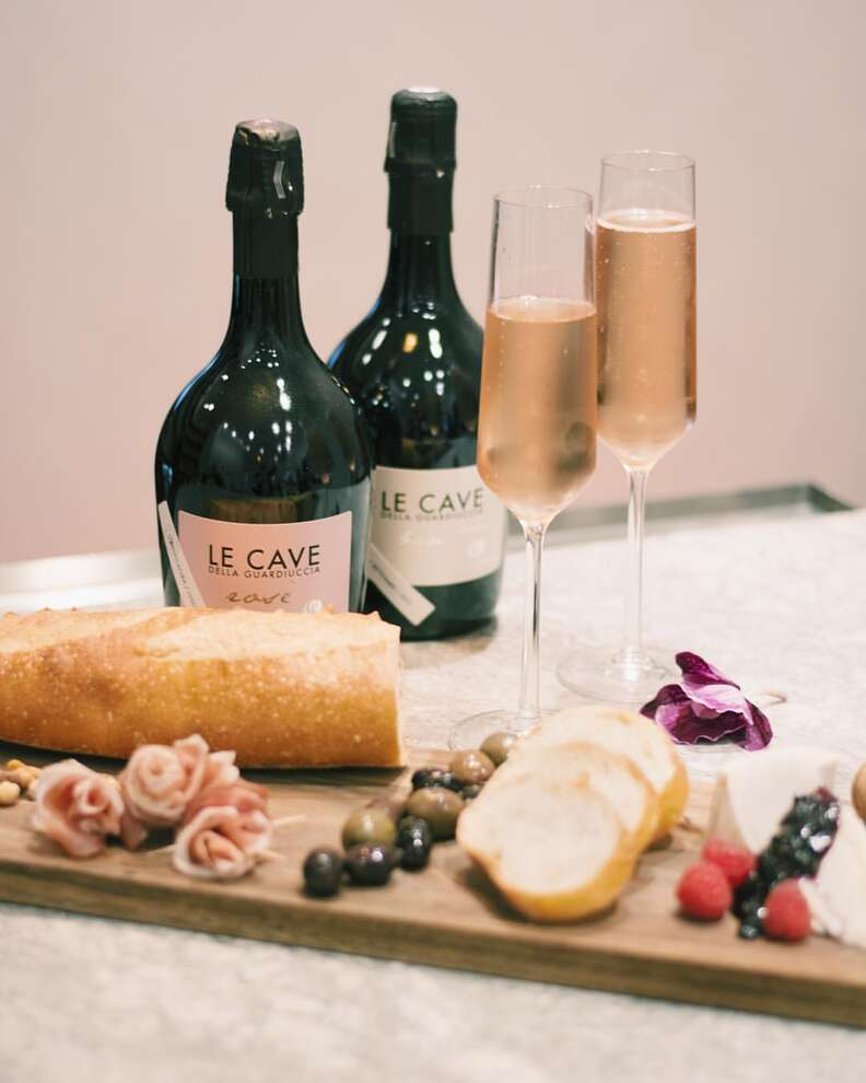 Glasses of Le Cave wine and charcuterie board at Market St. Wine Shop