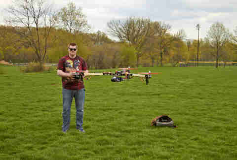 Man flies toy drone in a park