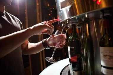 Man pouring wine from Amuse wine bar
