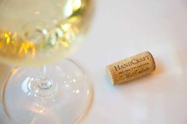 Glass of white wine with cork